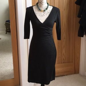 Bebe wool fitted dress, side ruched w/ a low Vneck